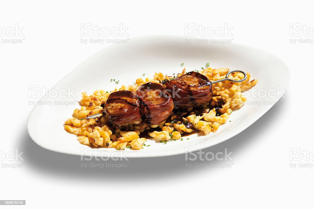 Medaillon of pork fillet and swabian noodles garnished with sauc stock photo
