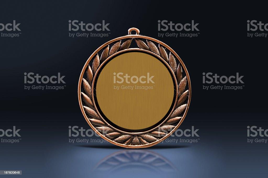 Medal in the spotlight stock photo