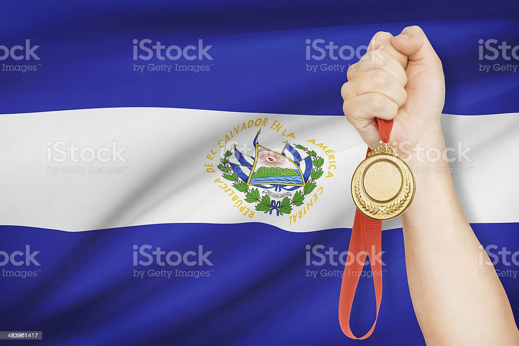Medal with flag on background - Republic of El Salvador stock photo