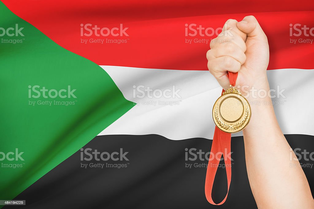 Medal with flag on background - Republic of the Sudan stock photo