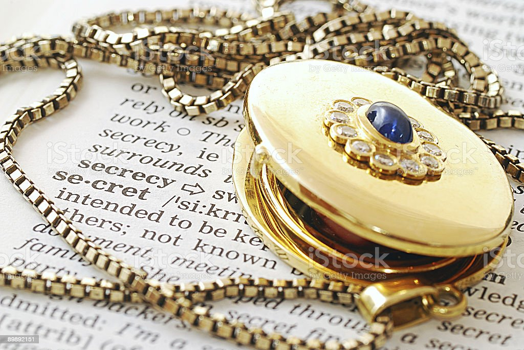 medallion on word secret in dictionary royalty-free stock photo