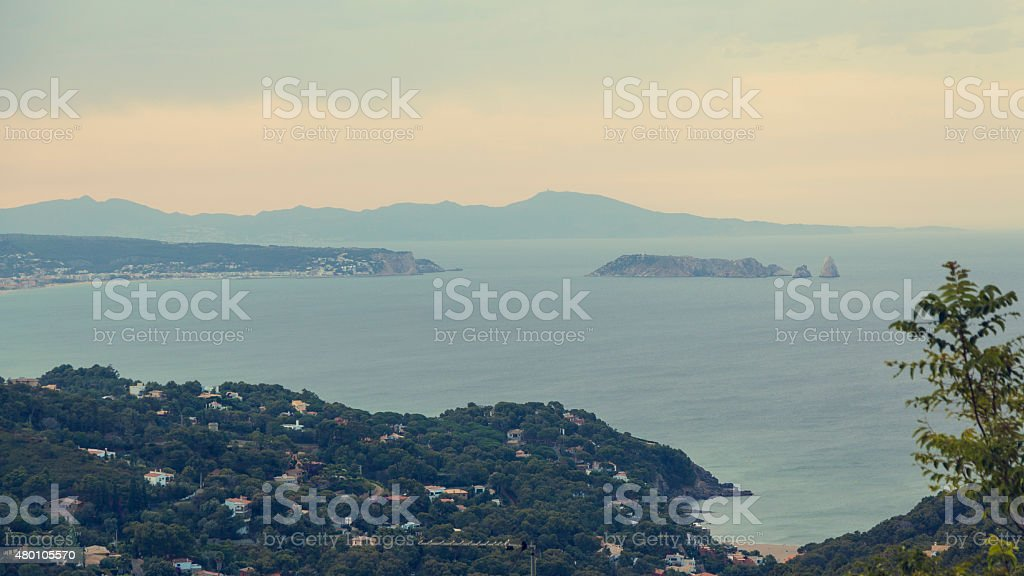 Medes Island in Mediterranean Catalonian shore on a blue sunset. stock photo
