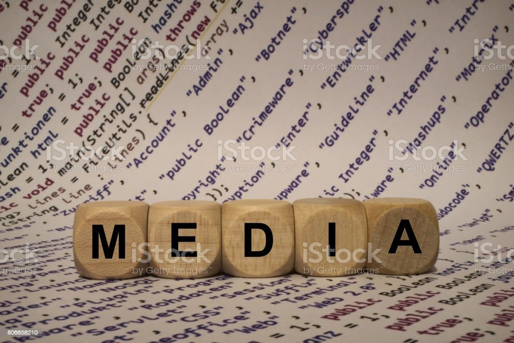 media - cube with letters and words from the computer, software, internet categories, wooden cubes stock photo
