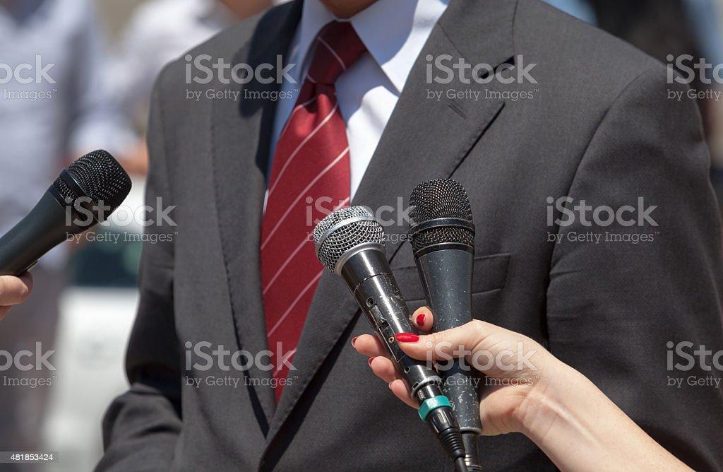 Media interview. Broadcast journalism. stock photo