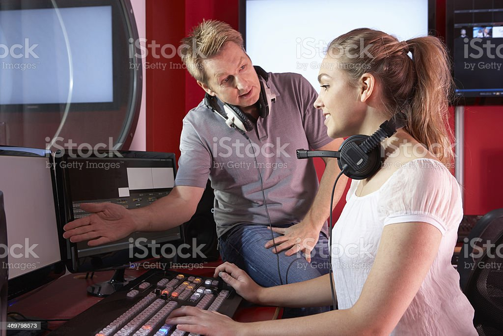 Media Student With Tutor Working In Film Editing Class stock photo
