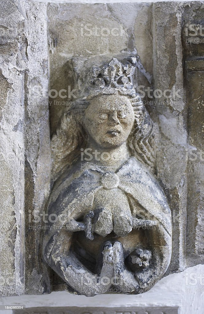 Stone statue Agatha patron saint of breast cancer sufferers stock photo
