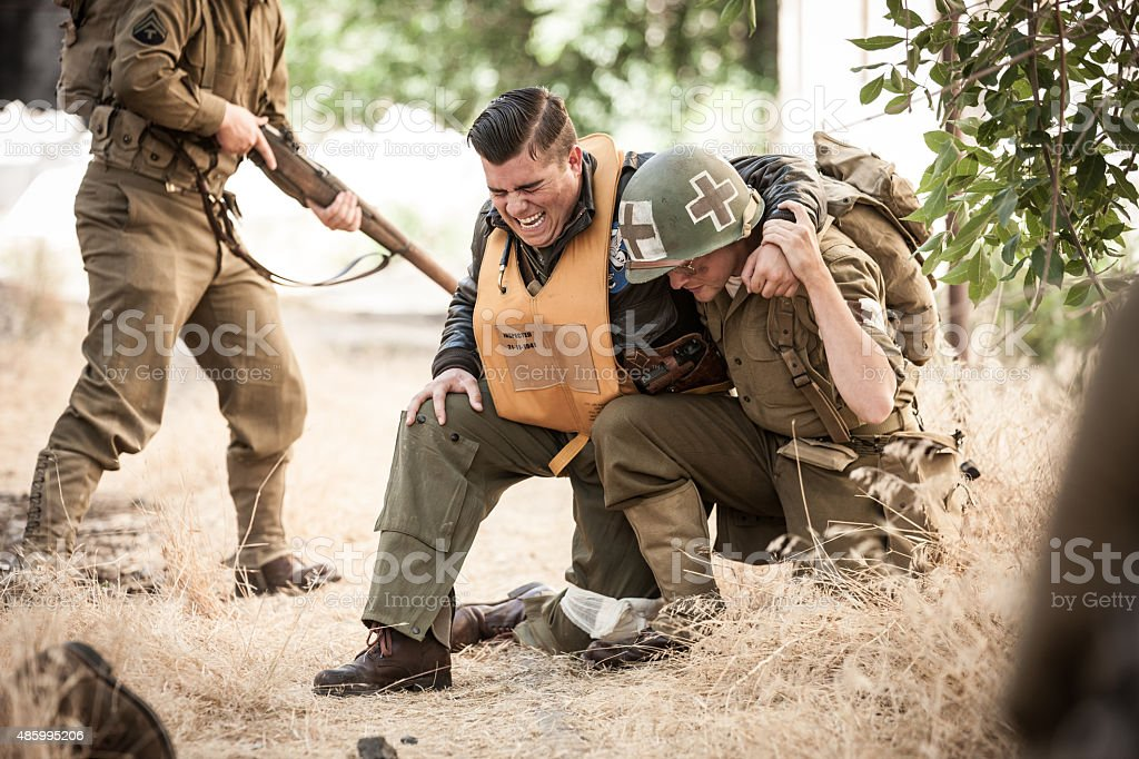 WWII Medic Helps Wounded Airman stock photo