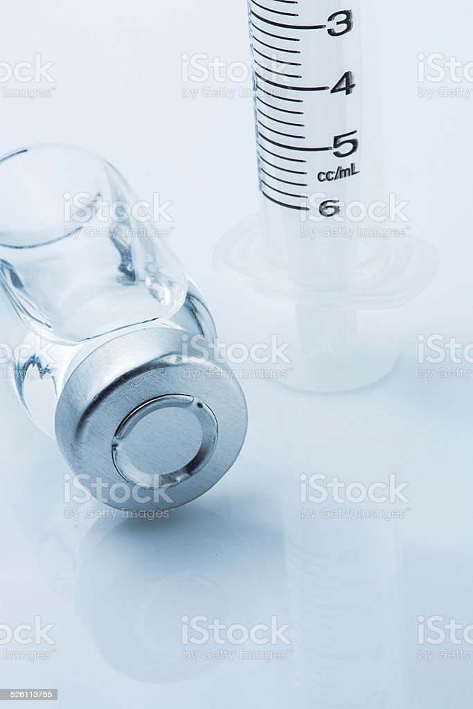 medical ampoules and syringe on white background stock photo