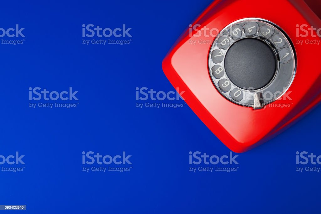 medical and red telephone on blue background stock photo