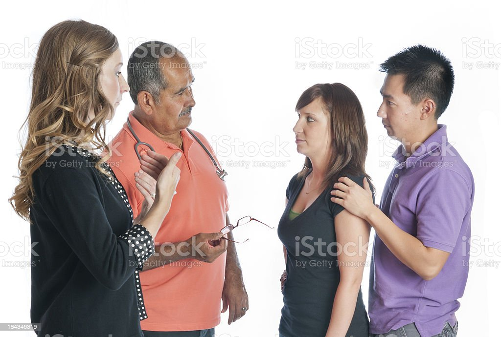 Medical ASL Interpreter Helps Doctor Inform Young Couple stock photo