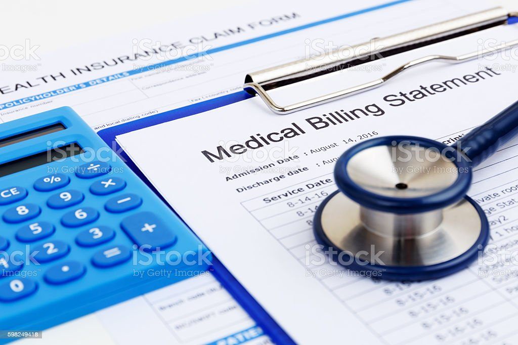 Medical bill and insurance form with calculator stock photo