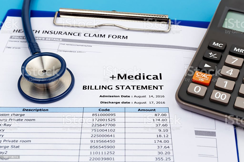 Medical bill with calculator stock photo
