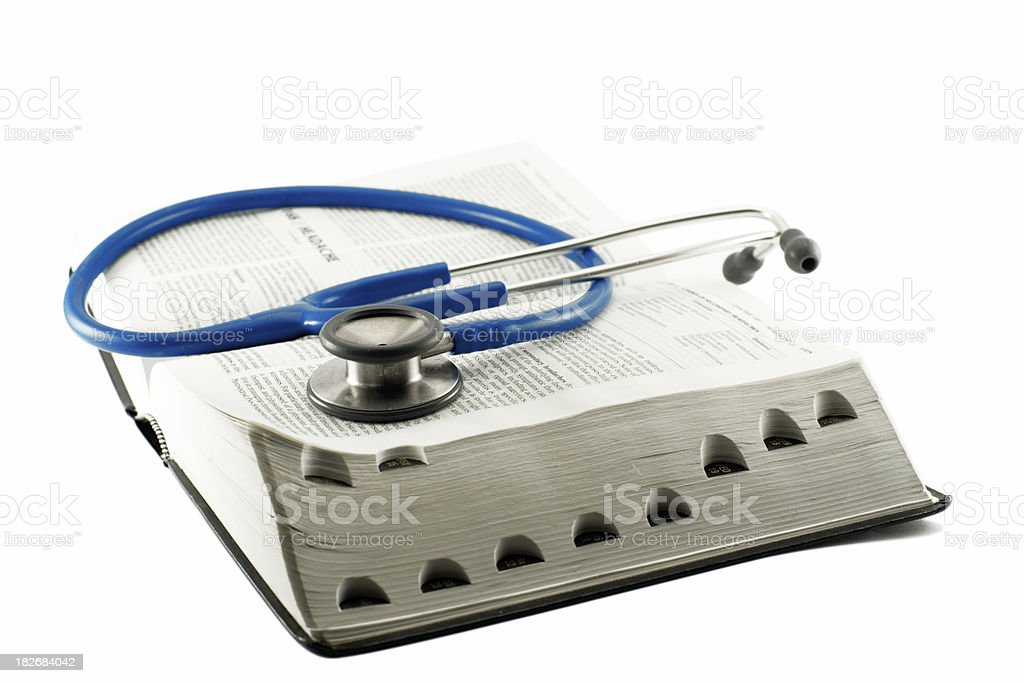 Medical book and stethoscope stock photo