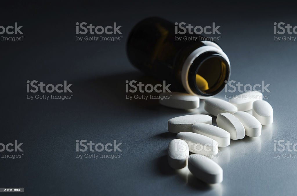 medical bottle and pills stock photo