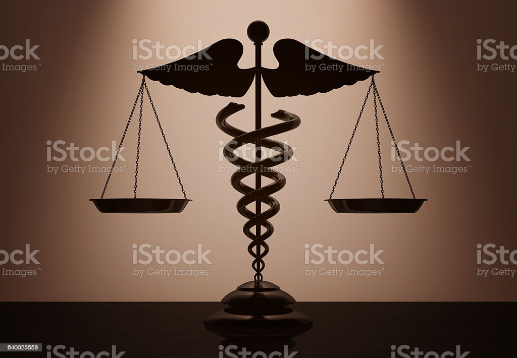 Medical Caduceus Symbol as Scales with backlight over Wall stock photo