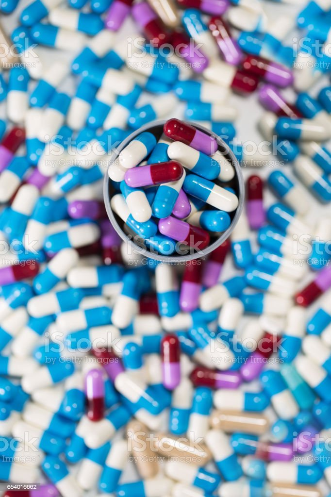 medical capsules pattern background, top view stock photo