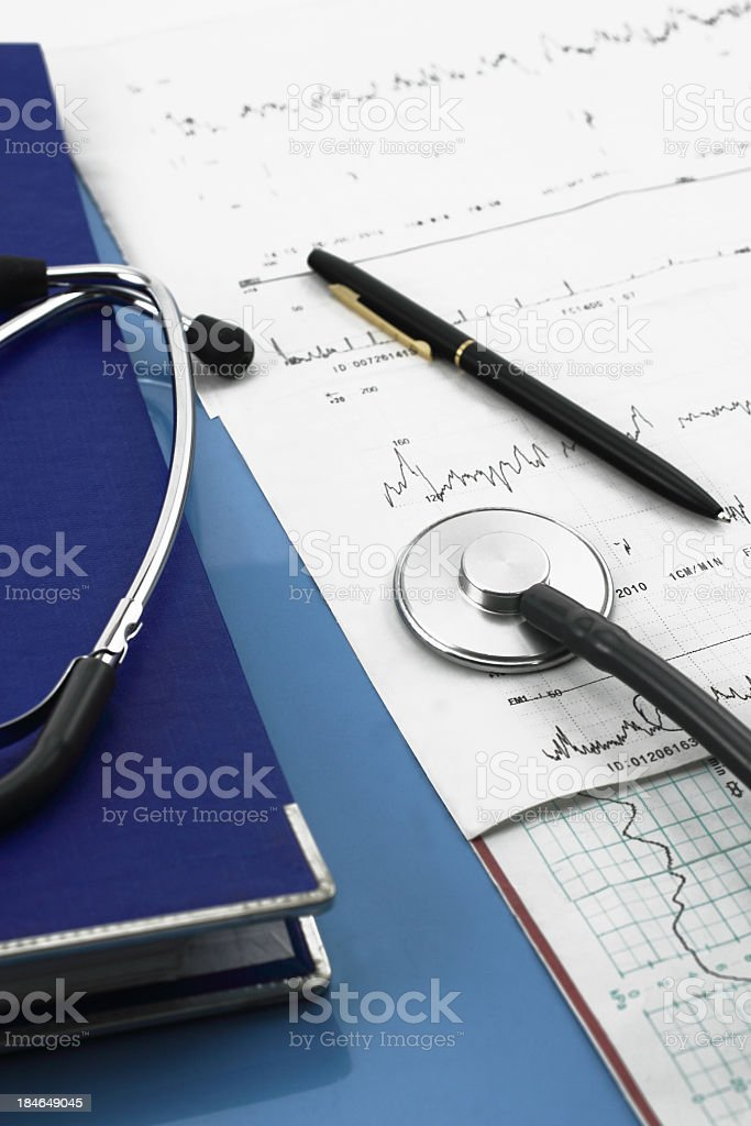 Medical charts and stethoscope stock photo