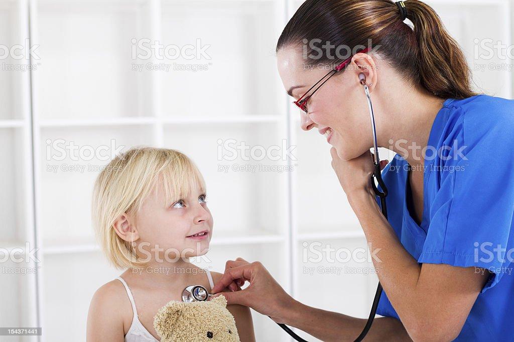medical checkup doctor examining little girl royalty-free stock photo