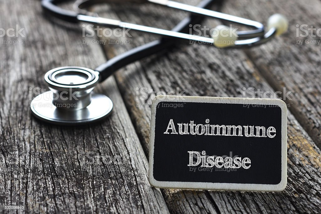Medical Concept- Autoimmune Disease word written on blackboard w stock photo