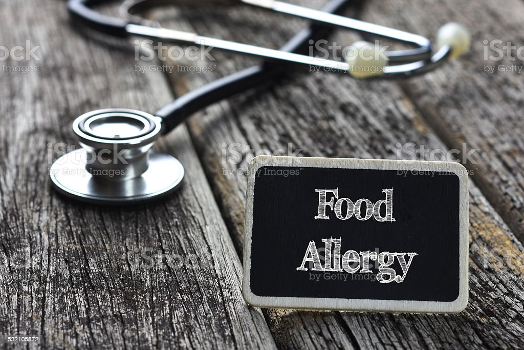Medical Concept- Food Allergy word written on blackboard with St stock photo