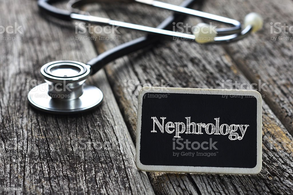 Medical Concept- Nephrology word written on blackboard with Stet stock photo