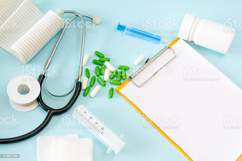 Medical conceptual picture with a stethoscope, pills, injection, gauze, adhesive stock photo