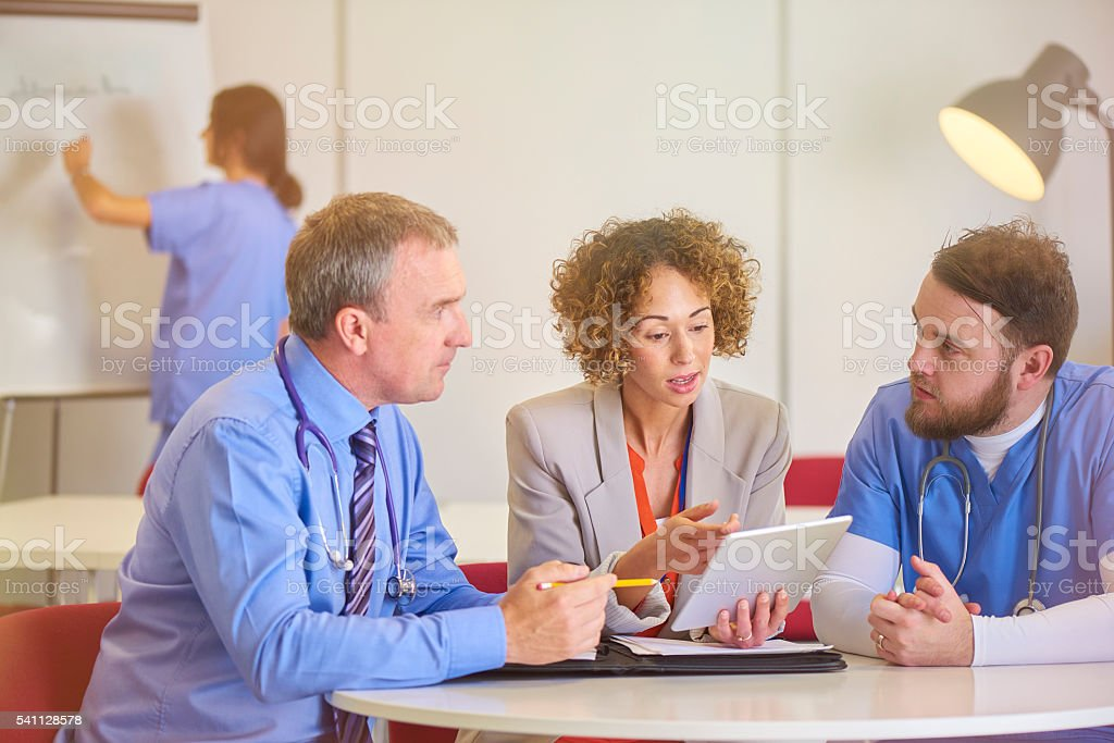 medical consultant with administrator stock photo