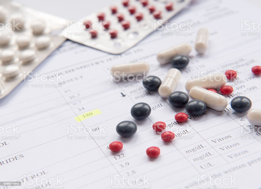 Medical diagnosis report and pills stock photo