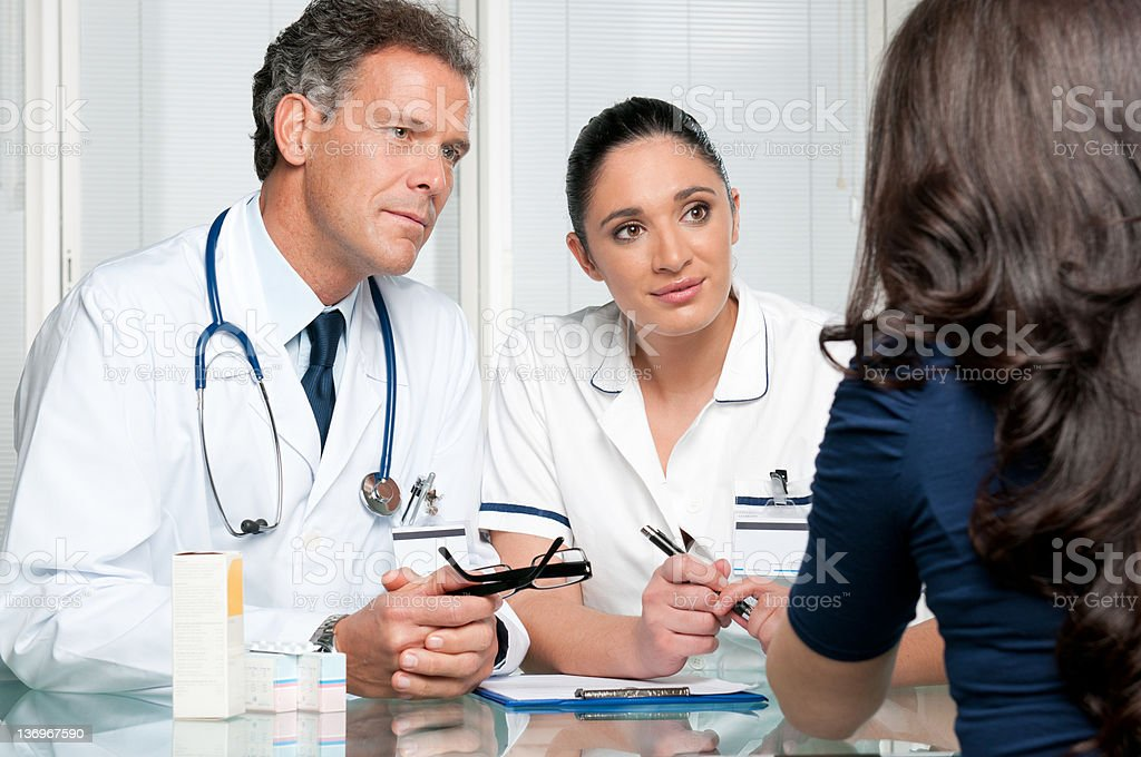 Medical discussion at hospital with patient stock photo