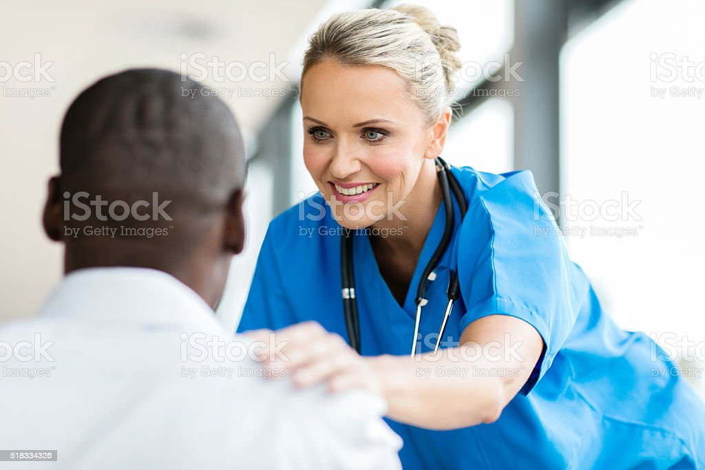 medical doctor comforting pateint stock photo