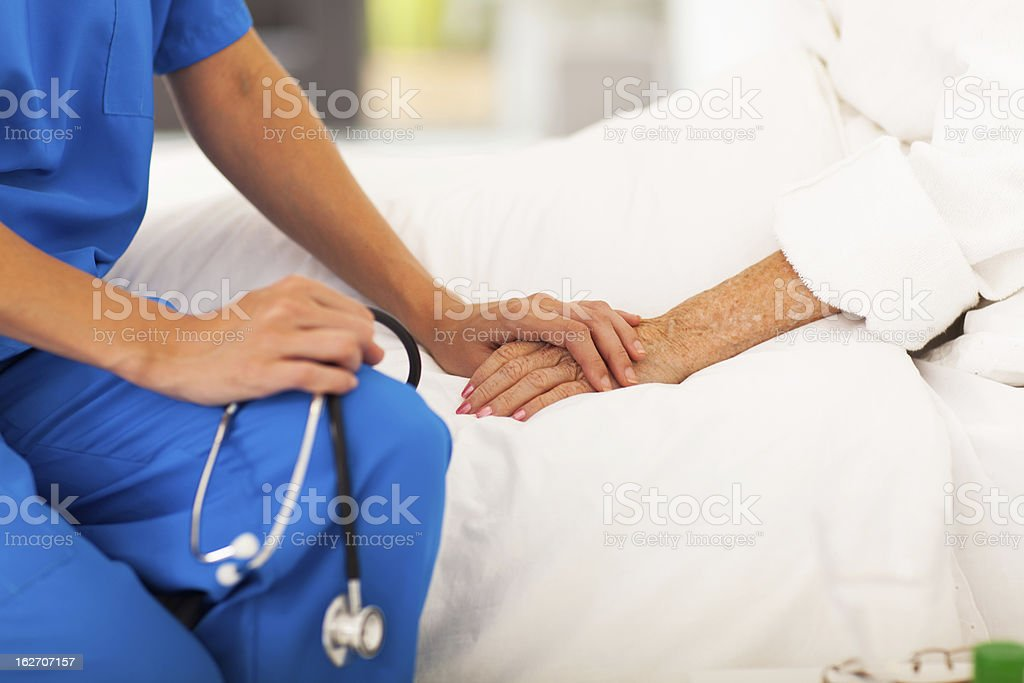 medical doctor comforting senior patient stock photo