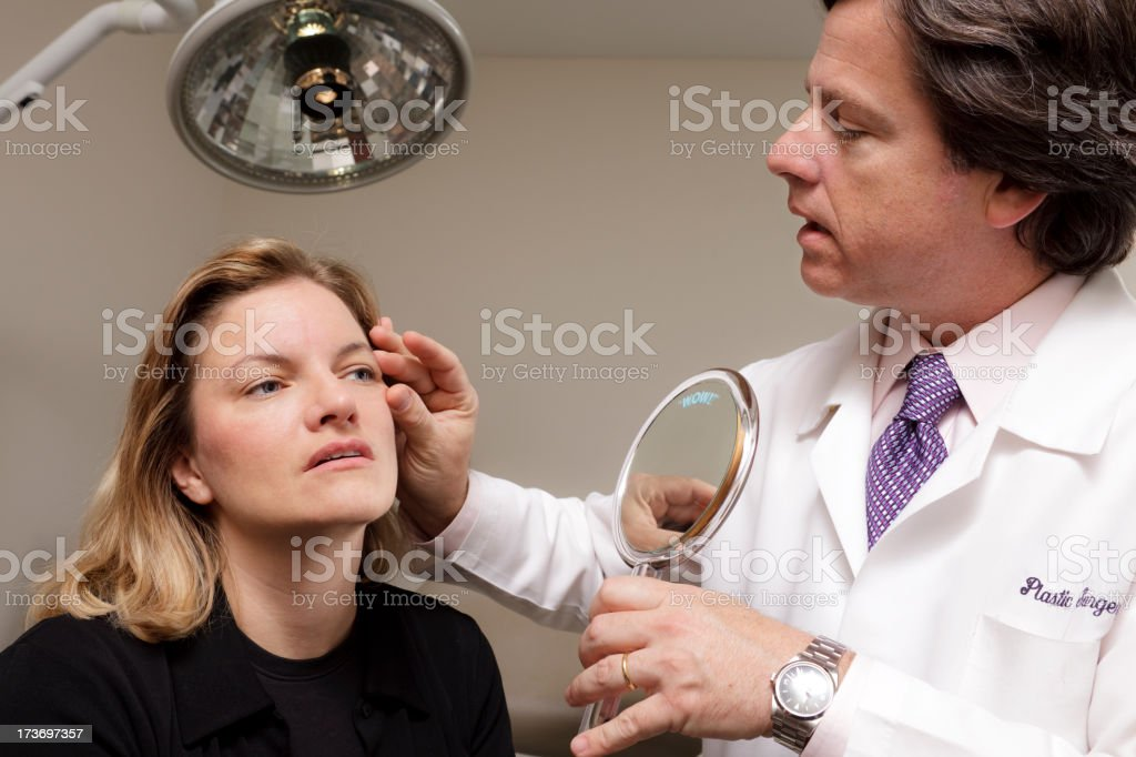 Medical Doctor Consults with Patient royalty-free stock photo
