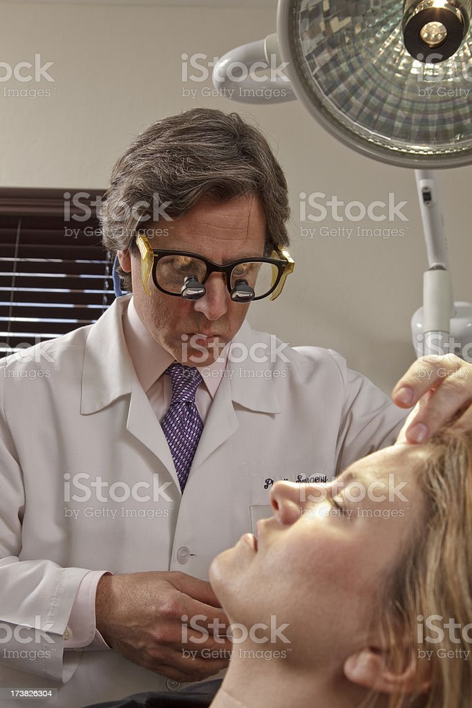 Medical Doctor During Procedure with Patient royalty-free stock photo