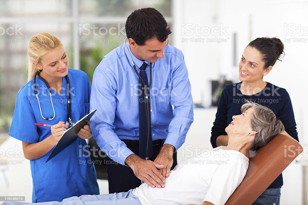 medical doctor examining senior patient stock photo