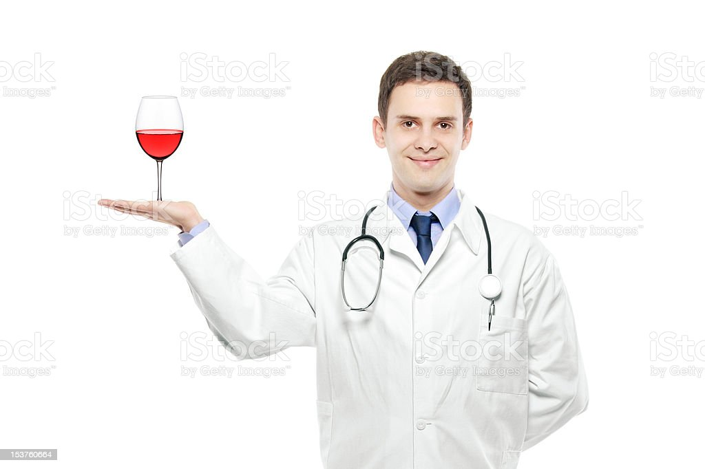 Medical doctor holding a wine glass royalty-free stock photo