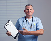Medical doctor holding clipboard.