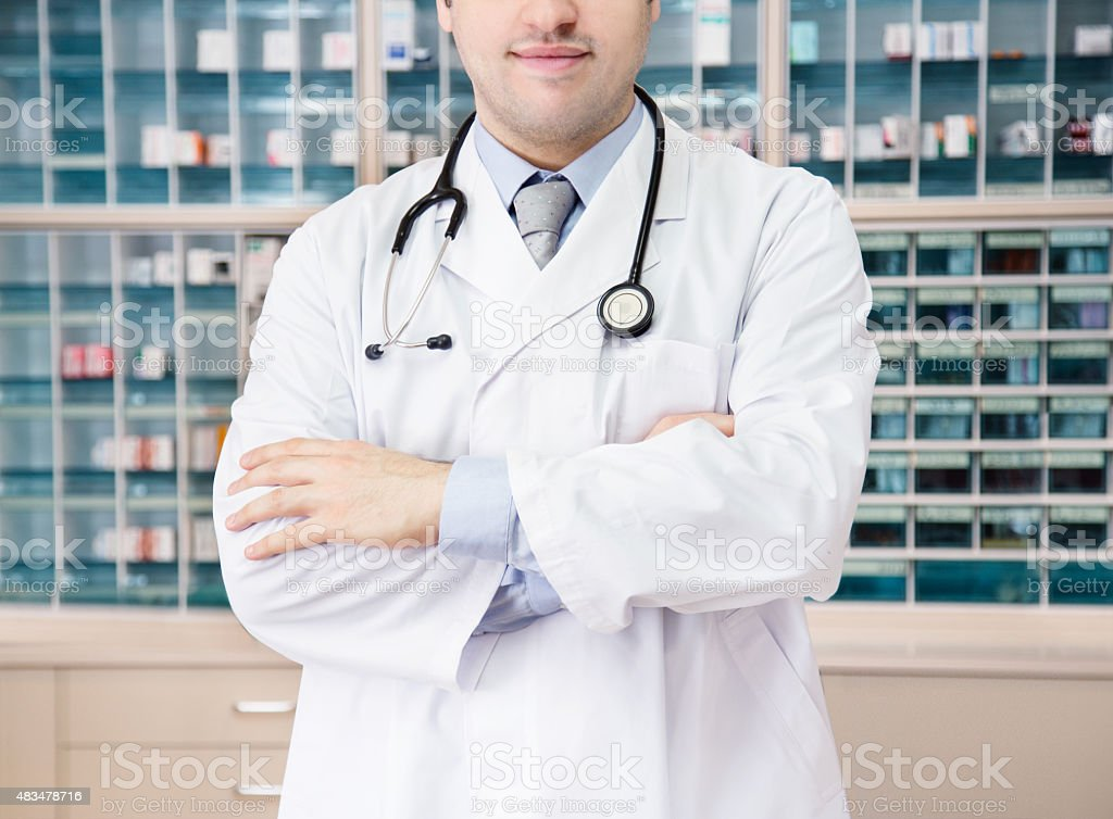 Medical doctor in front of medicine cabinet. hospital clinic. stock photo