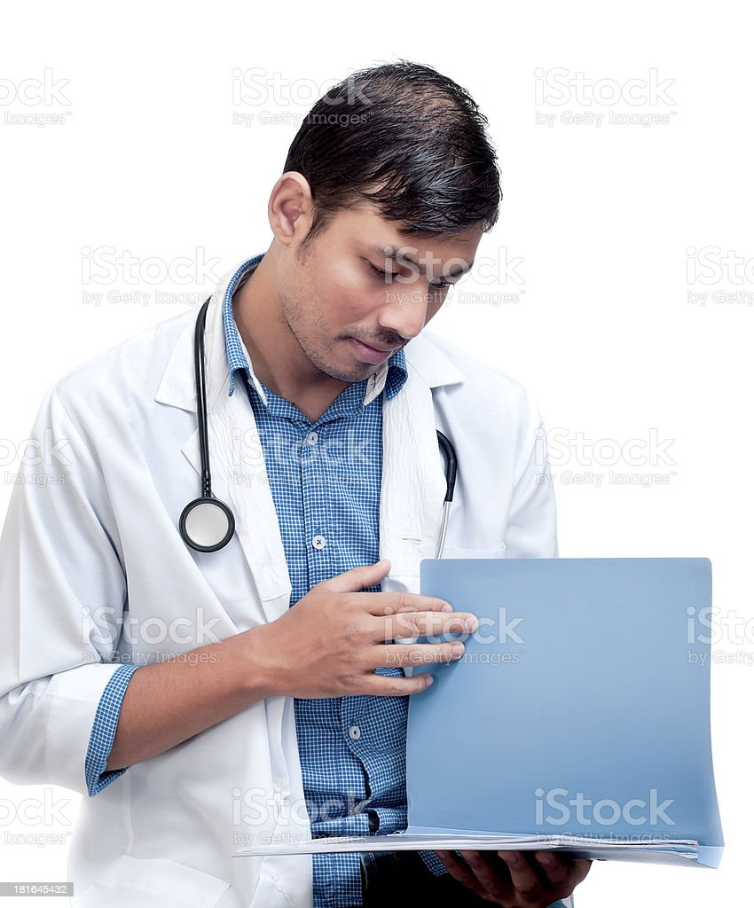 Medical Doctor Looking at Patient Chart royalty-free stock photo