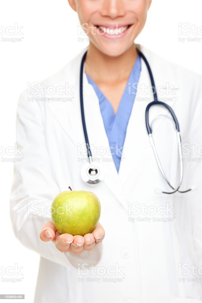 Medical doctor showing apple stock photo