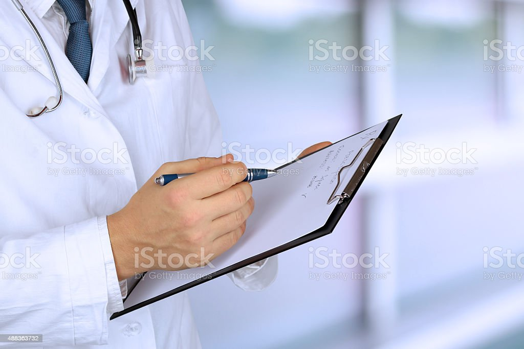 medical doctor  with a stethoscope holding  a black folder stock photo