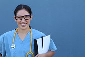 Medical doctor with stethoscope over blue background