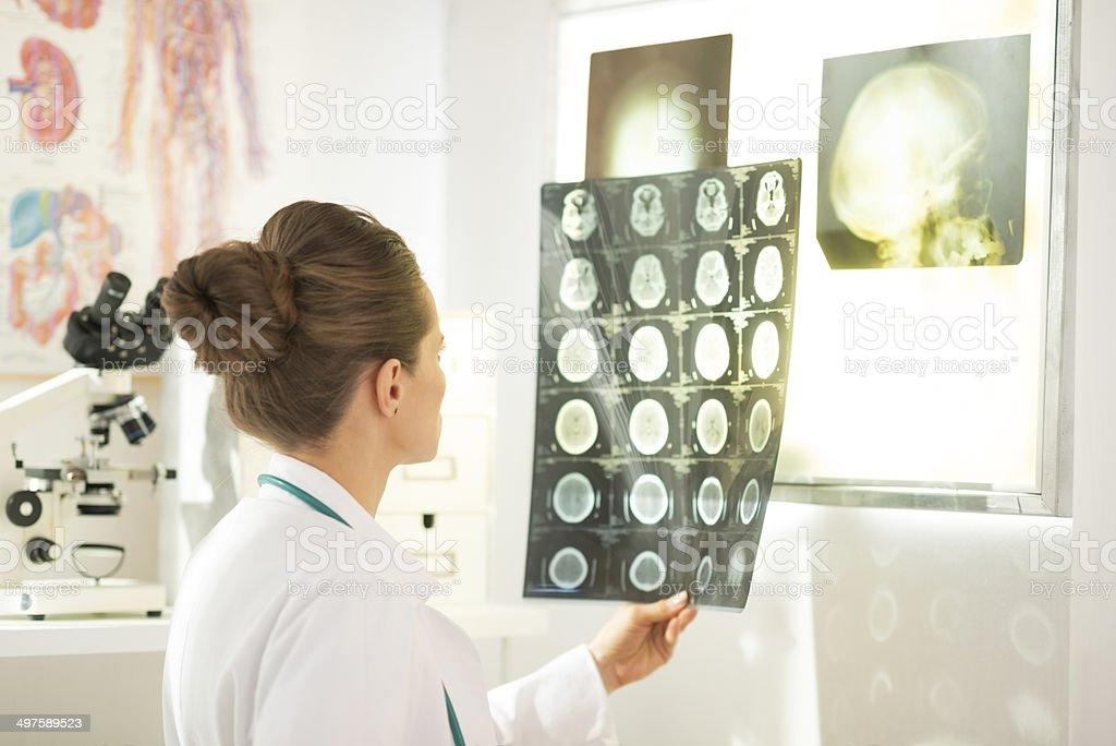 medical doctor woman looking on tomography stock photo