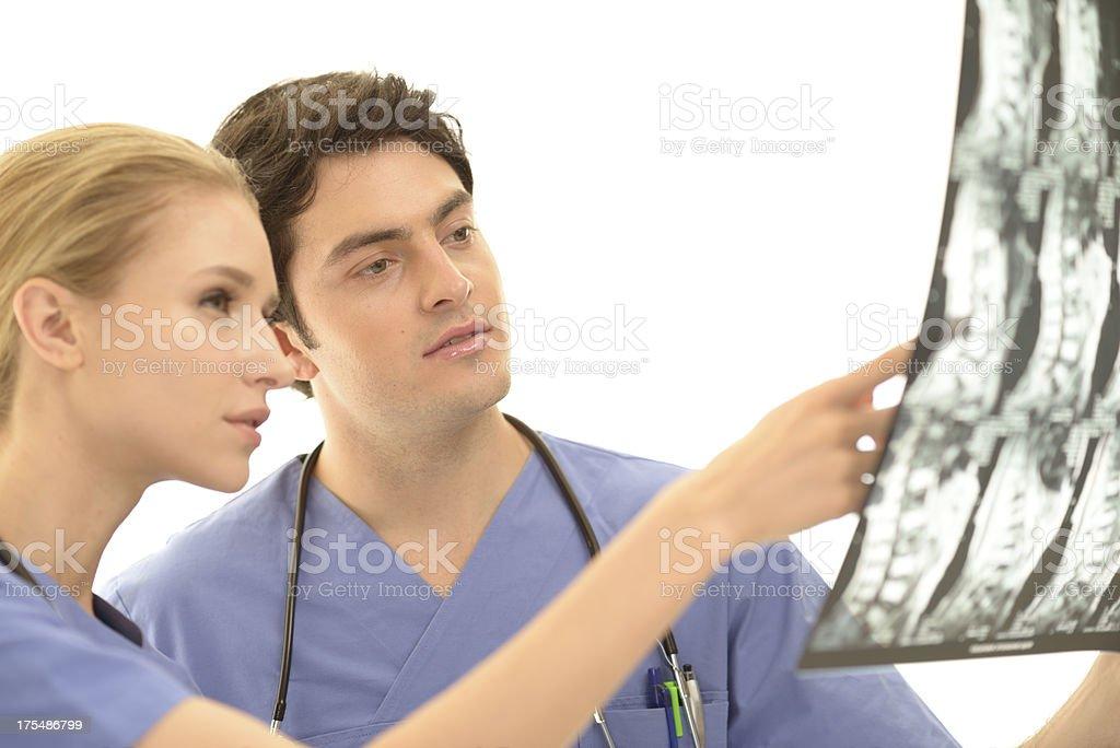 Medical doctors examining MRI scan royalty-free stock photo