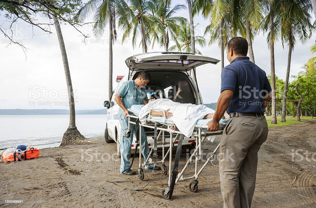 Medical emergency on a tropical beach royalty-free stock photo