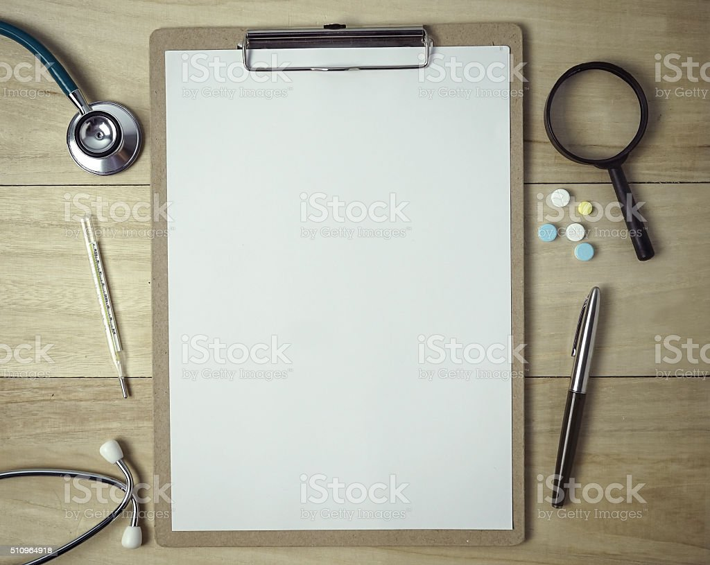 medical equipment and white paper on a clipboard stock photo