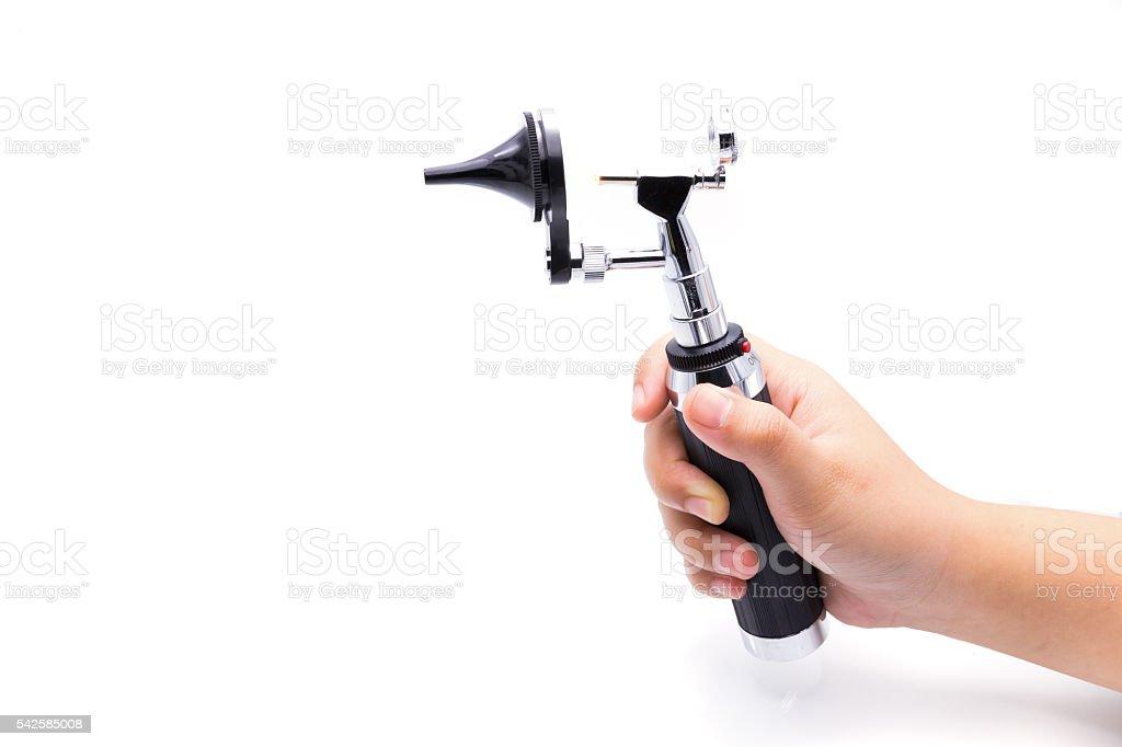 Medical equipment diagnostic ear exam.Otoscope on white backgrou stock photo