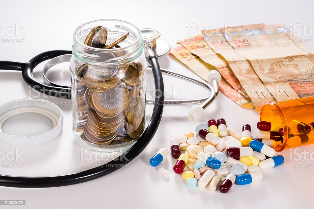 Medical equipment, drugs and money. stock photo