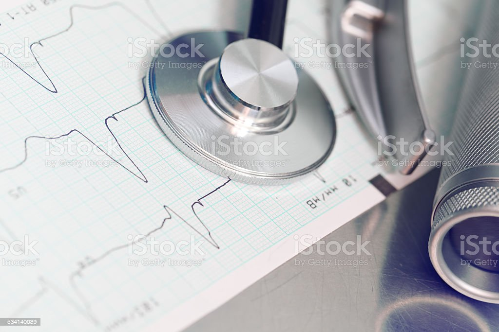 Medical equipment on the recorded ECG stock photo