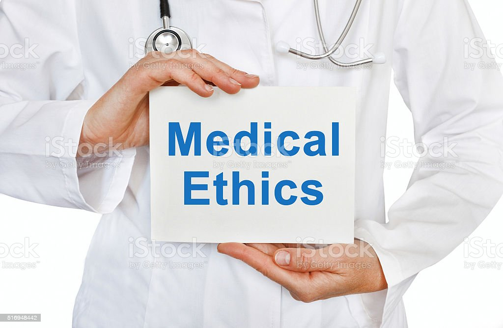 Medical Ethics card in hands of Medical Doctor stock photo
