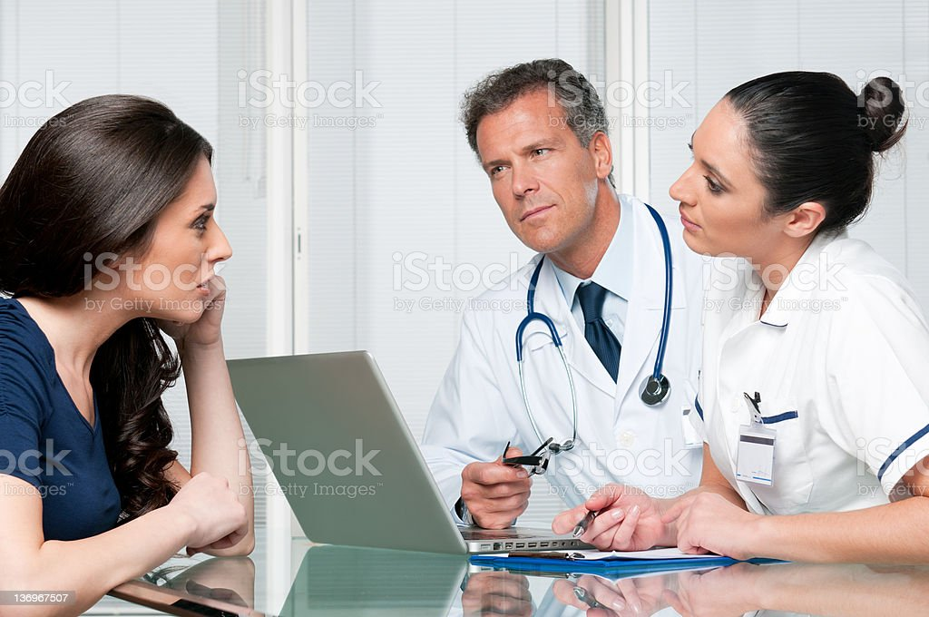 Medical exam discussion royalty-free stock photo